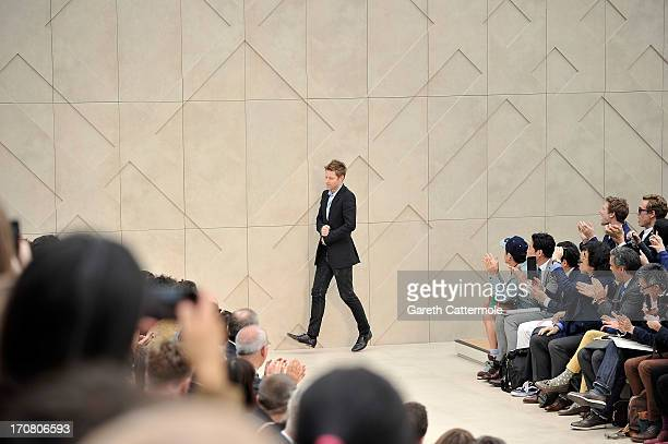 Christopher Bailey takes the applause after the Burberry Menswear Spring/Summer 2014 at Kensington Gardens on June 18, 2013 in London, England.