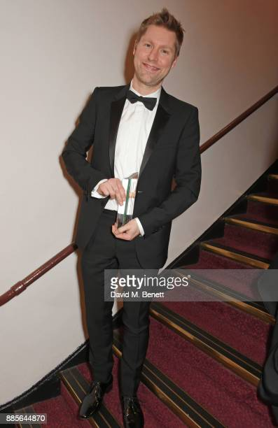 Christopher Bailey, winner of the Outstanding Contribution to British Fashion Award, poses backstage at The Fashion Awards 2017 in partnership with...