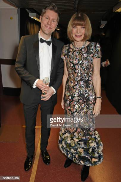 Christopher Bailey winner of the Outstanding Contribution to British Fashion Award and Dame Anna Wintour pose backstage at The Fashion Awards 2017 in...