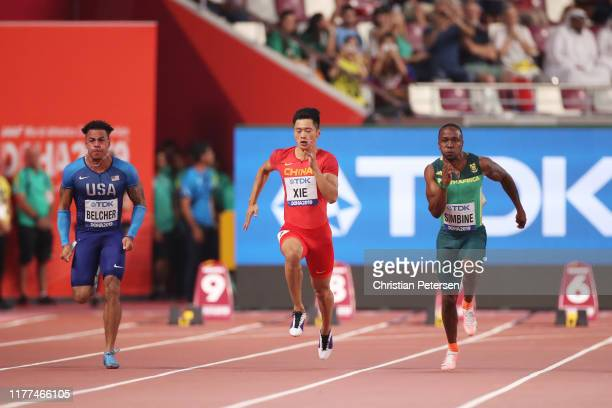 Christopher Belcher of the United States Zhenye Xie of China and Akani Simbine of South Africa compete in the Men's 100 metres heats during day one...