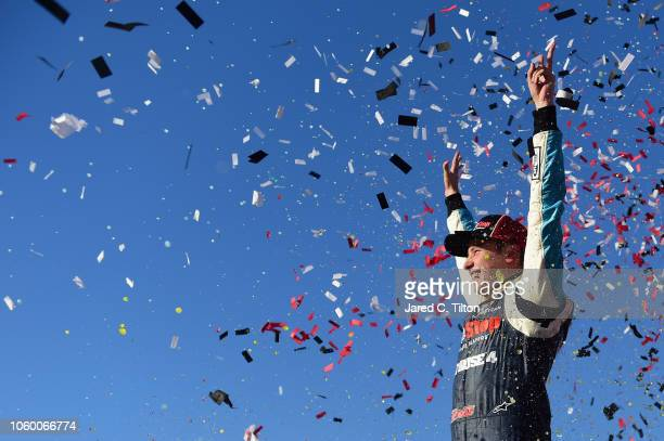 Christopher Bell driver of the GameStop Just Cause 4 Toyota celebrates in Victory Lane after winning the NASCAR Xfinity Series Whelen Trusted To...