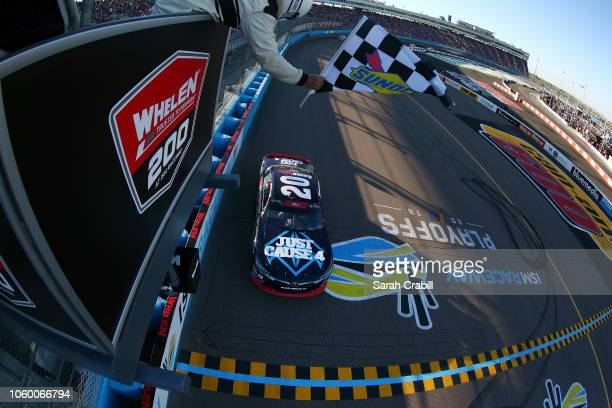 Christopher Bell, driver of the GameStop Just Cause 4 Toyota, takes the checkered flag to win the NASCAR Xfinity Series Whelen Trusted To Perform 200...