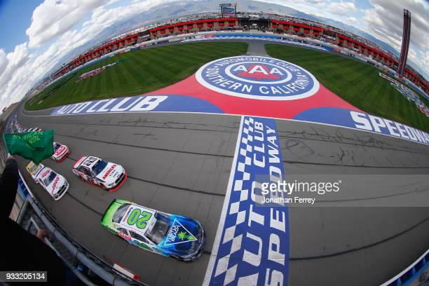 Christopher Bell driver of the GameStop/Turtle Beach Toyota leads the field to the green flag to start the NASCAR Xfinity Series Roseanne 300 at Auto...