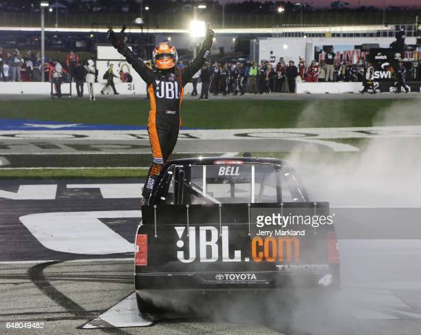 Christopher Bell driver of the JBL Toyota celebrates after winning the NASCAR Camping World Truck Series Active Pest Control 200 at Atlanta Motor...