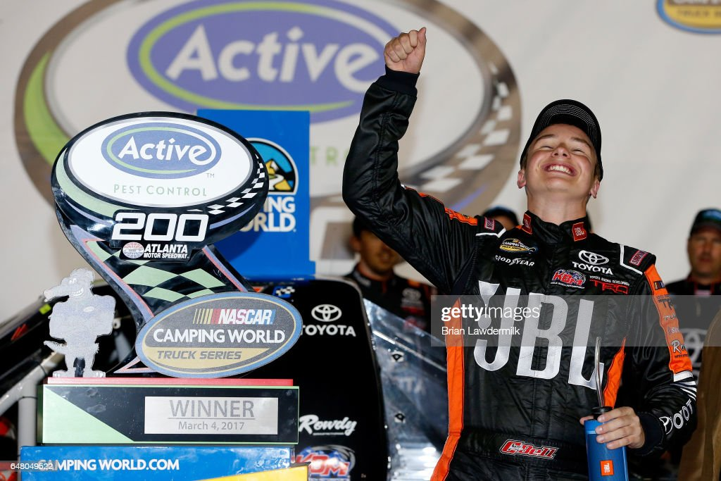 Christopher Bell, driver of the #4 JBL Toyota, celebrates in Victory Lane after winning the NASCAR Camping World Truck Series Active Pest Control 200 at Atlanta Motor Speedway on March 4, 2017 in Hampton, Georgia.