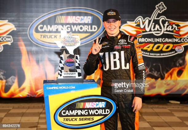 Christopher Bell driver of the JBL Toyota celebrates in Victory Lane after winning the NASCAR Camping World Truck Series winstaronlinegamingcom 400...