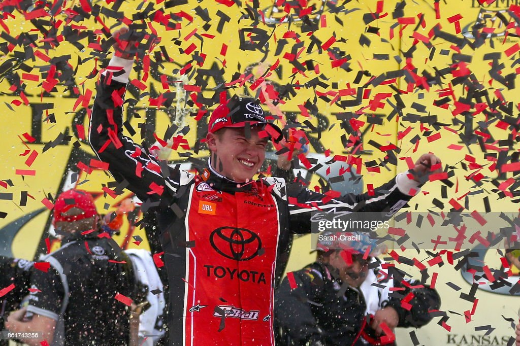 Christopher Bell, driver of the #18 JBL Toyota, celebrates in Victory Lane after winning the NASCAR XFINITY Series Kansas Lottery 300 at Kansas Speedway on October 21, 2017 in Kansas City, Kansas.