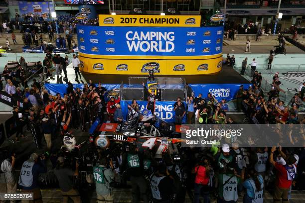 Christopher Bell driver of the JBL Toyota celebrates in Victory Lane after placing second and winning the Camping World Truck Series Championship...