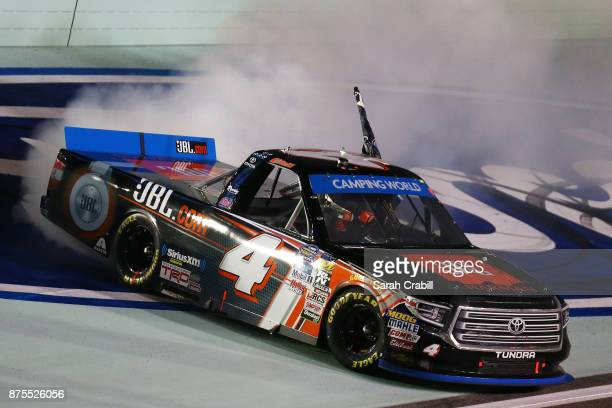 Christopher Bell driver of the JBL Toyota celebrates with a burnout after placing second and winning the Camping World Truck Series Championship...