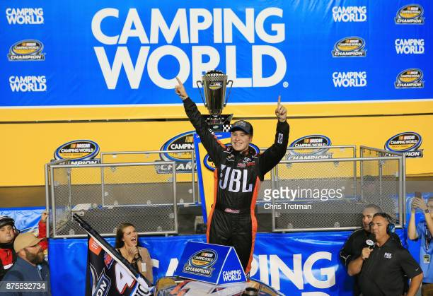 Christopher Bell driver of the JBL Toyota celebrates with the trophy in Victory Lane after placing second and winning the Camping World Truck Series...
