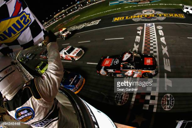 Christopher Bell driver of the JBL Toyota crosses the finish line under caution to win the NASCAR Camping World Truck Series winstaronlinegamingcom...