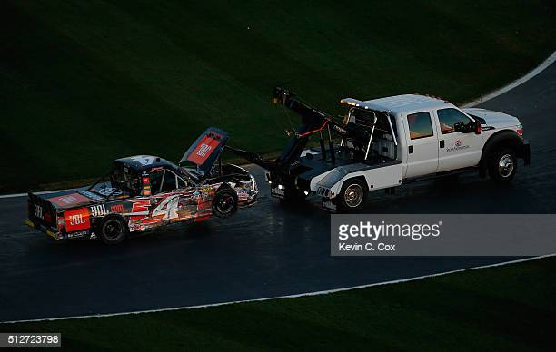 Christopher Bell driver of the JBL Toyota is towed to the garage after an on track incident during the NASCAR Camping World Truck Series Great Clips...