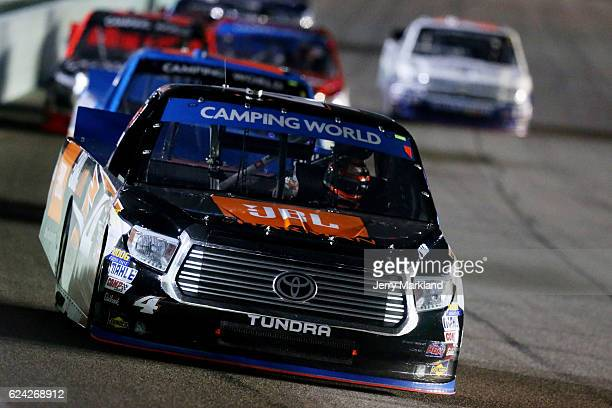 Christopher Bell driver of the JBL Toyota leads a pack of trucks during the NASCAR Camping World Truck Series Ford EcoBoost 200 at HomesteadMiami...