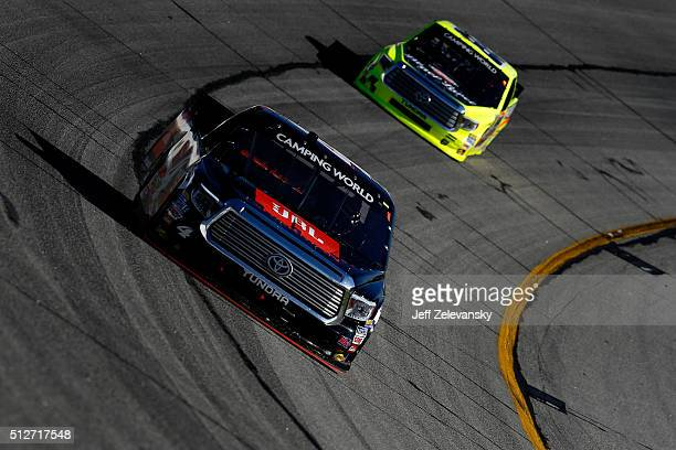 Christopher Bell driver of the JBL Toyota leads Matt Crafton driver of the Hormel/Menards Toyota during the NASCAR Camping World Truck Series Great...