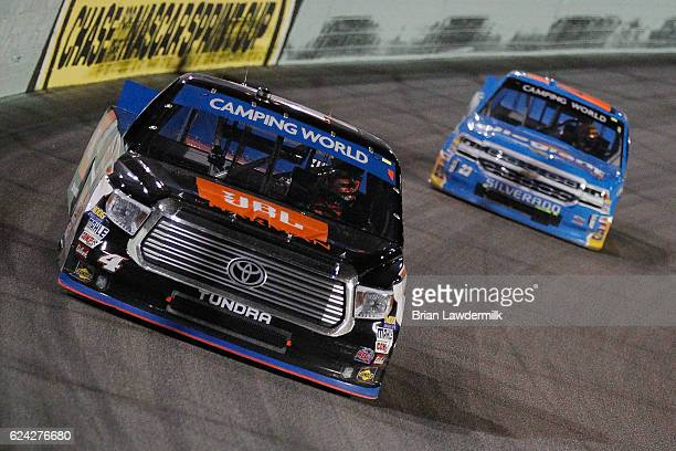 Christopher Bell driver of the JBL Toyota leads Spencer Gallagher driver of the Allegiant Travel Chevrolet during the NASCAR Camping World Truck...