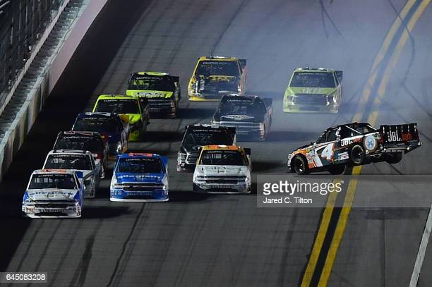 Christopher Bell driver of the JBL Toyota lifts into the air in during the NASCAR Camping World Truck Series NextEra Energy Resources 250 at Daytona...