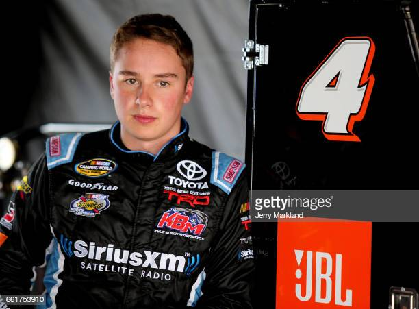 Christopher Bell driver of the JBL Toyota looks on from the garage during practice for the NASCAR Camping World Truck Series Alpha Energy Solutions...