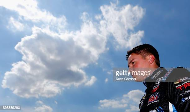 Christopher Bell driver of the JBL Toyota looks on from the garage during practice for the NASCAR Camping World Truck Series winstaronlinegamingcom...