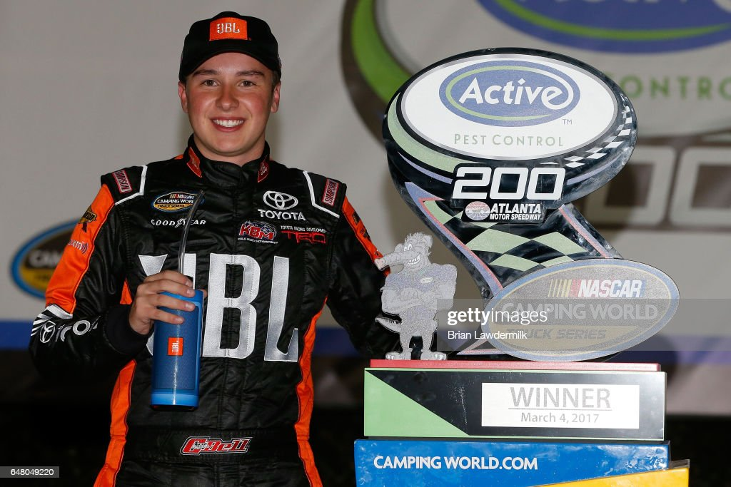 Christopher Bell, driver of the #4 JBL Toyota, poses with the trophy after winning the NASCAR Camping World Truck Series Active Pest Control 200 at Atlanta Motor Speedway on March 4, 2017 in Hampton, Georgia.