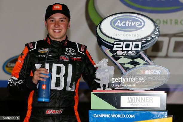 Christopher Bell driver of the JBL Toyota poses with the trophy after winning the NASCAR Camping World Truck Series Active Pest Control 200 at...