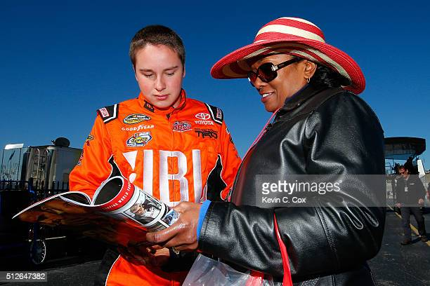 Christopher Bell driver of the JBL Toyota signs an autograph during qualifying for the NASCAR Camping World Truck Series Great Clips 200 at Atlanta...