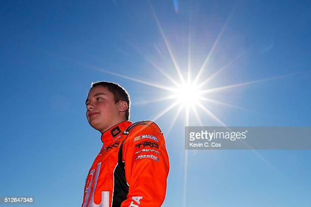 Christopher Bell driver of the JBL Toyota stands on the grid during qualifying for the NASCAR Camping World Truck Series Great Clips 200 at Atlanta...