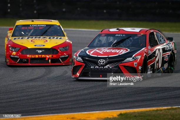 Christopher Bell, driver of the Rheem Toyota, and Joey Logano, driver of the Shell Pennzoil Ford, race during the NASCAR Cup Series O'Reilly Auto...
