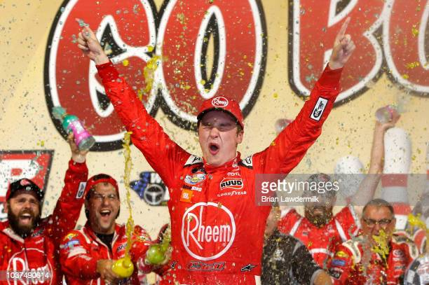 Christopher Bell driver of the Rheem Toyota celebrates in Victory lane after winning the NASCAR Xfinity Series Go Bowling 250 at Richmond Raceway on...