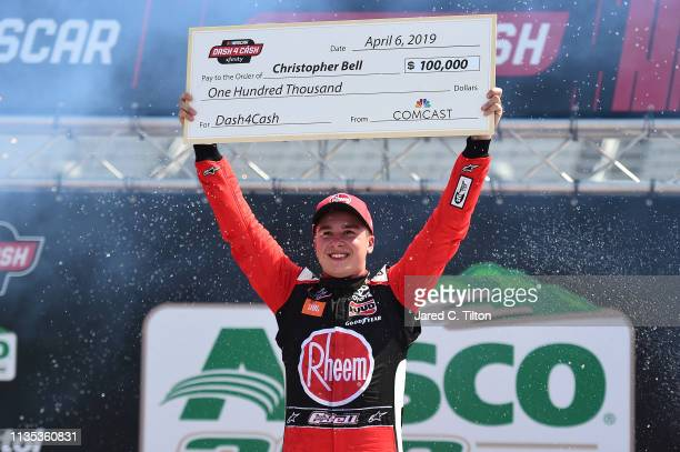 Christopher Bell driver of the Rheem Toyota celebrates in Victory Lane with the Xfinity Dash 4 Cash check after winning the NASCAR Xfinity Series...