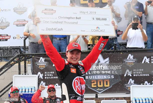 Christopher Bell driver of the Rheem Toyota celebrates in Victory Lane after winning the Dash 4 Cash and the NASCAR Xfinity Series Allied Steel...