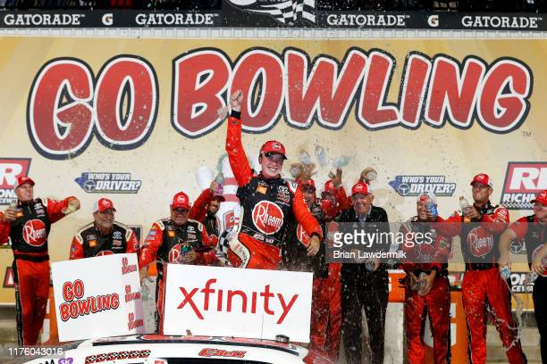 Christopher Bell driver of the Rheem Toyota celebrates in Victory Lane after winning the NASCAR Xfinity Series GoBowling 250 at Richmond Raceway on...