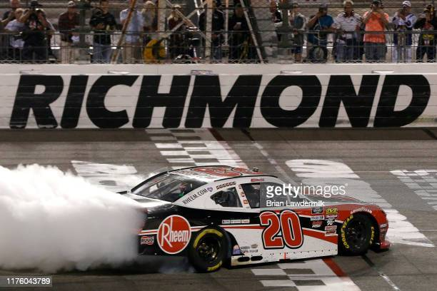 Christopher Bell driver of the Rheem Toyota celebrates with a burnout after winning the NASCAR Xfinity Series GoBowling 250 at Richmond Raceway on...