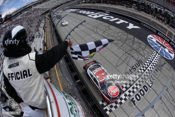 Christopher Bell driver of the Rheem Toyota crosses the finish line to win the NASCAR Xfinity Series Alsco 300 at Bristol Motor Speedway on April 6...