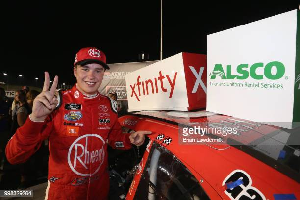 Christopher Bell driver of the Rheem Toyota poses in Victory Lane with the winner's decal after winning the NASCAR Xfinity Series Alsco 300 at...
