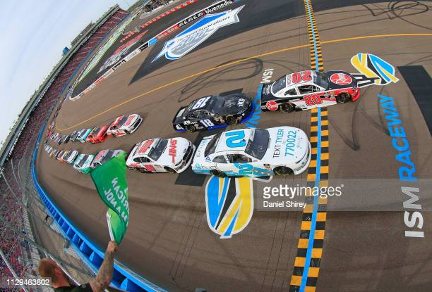 Christopher Bell driver of the Rheem Toyota takes the green flag to start the NASCAR Xfinity Series iK9 Service Dog 200 at ISM Raceway on March 9...