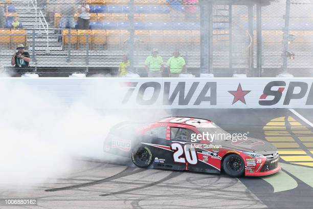 Christopher Bell driver of the Ruud Toyota celebrates with a burnout after winning the NASCAR Xfinity Series US Cellular 250 presented by The...
