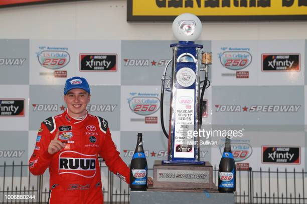 Christopher Bell, driver of the Ruud Toyota, poses with the trophy after winning the NASCAR Xfinity Series U.S. Cellular 250 presented by The...