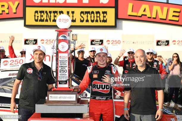 Christopher Bell, driver of the Ruud Toyota, poses with the trophy after winning the NASCAR Xfinity Series CircuitCity.com 250 Presented by Tamron at...