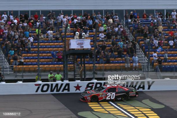 Christopher Bell driver of the Ruud Toyota takes the checkered flag to win the NASCAR Xfinity Series US Cellular 250 presented by The Rasmussen Group...