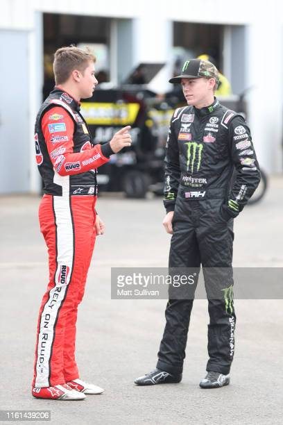 Christopher Bell driver of the Ruud Toyota talks with Riley Herbst driver of the Monster Energy Toyota during practice for the NASCAR Xfinity Series...