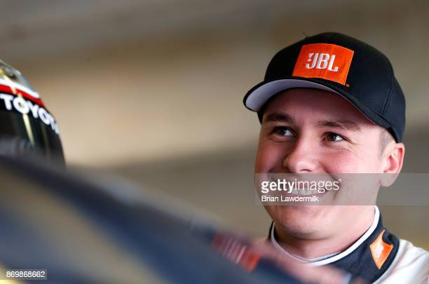 Christopher Bell driver of the Safelite Toyota stands in the garage area during practice for the NASCAR XFINITY Series O'Reilly Auto Parts 300 at...