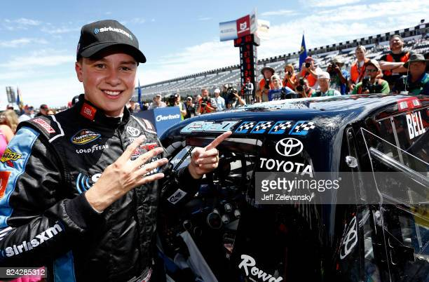 Christopher Bell driver of the SiriusXM Toyota celebrates in Victory Lane after winning during the NASCAR Camping World Truck Series Overton's 150 at...