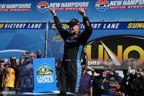 Christopher Bell driver of the SiriusXM Toyota celebrates in Victory Lane after winning the NASCAR Camping World Truck Series UNOH 175 at New...
