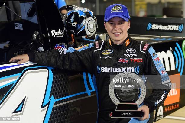 Christopher Bell driver of the SiriusXM Toyota poses for a photo opportunity on pit road with the regular season champion's trophy following the...