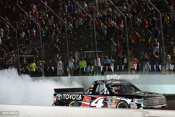 Christopher Bell driver of the Toyota Toyota celebrates with a burnout after winning the NASCAR Camping World Truck Series Drivin' for Linemen 200 at...