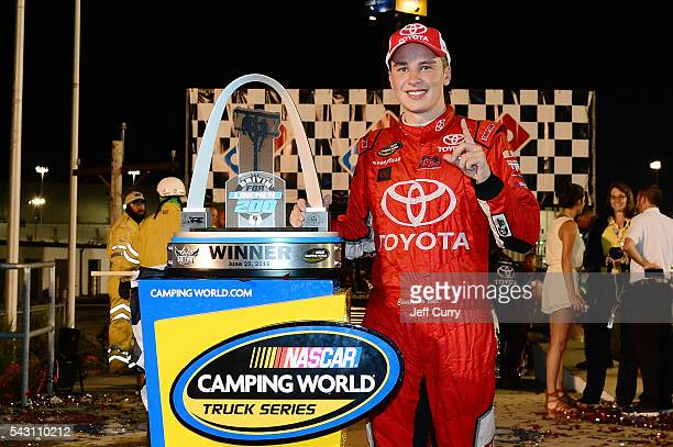 Christopher Bell driver of the Toyota Toyota poses for a picture after winning the NASCAR Camping World Truck Series Drivin' for Linemen 200 at...