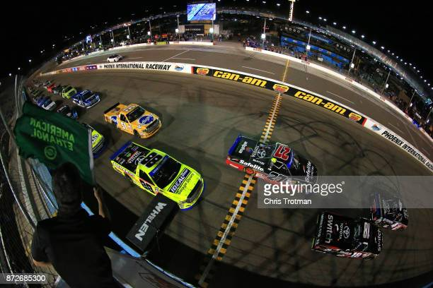 Christopher Bell driver of the Toyota Toyota takes the green flag to start the NASCAR Camping World Truck Series Lucas Oil 150 at Phoenix...