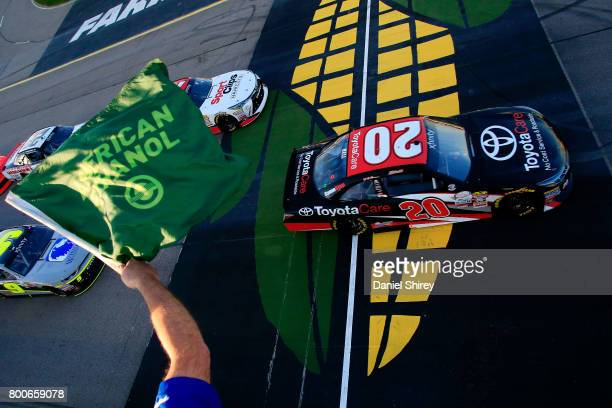 Christopher Bell driver of the ToyotaCare Toyota leads the field past the green flag to start the NASCAR XFINITY Series American Ethanol E15 250 at...