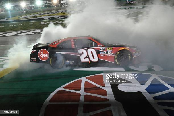 Christopher Bell Joe Gibbs Racing Toyota Camry does a burnout on the finish line after winning the NASCAR Xfinity Series Alsco 300 on July 13th at...