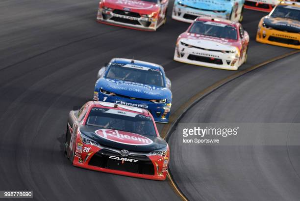Christopher Bell Joe Gibbs Racing Toyota Camry leads a pack of cars through turn four during the NASCAR Xfinity Series Alsco 300 on July 13th at...